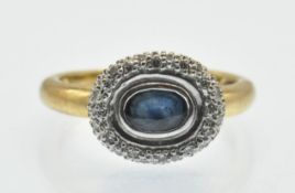 A hallmarked 18ct gold Sapphire and diamond cluster ring. The ring set with a central oval mixed cut