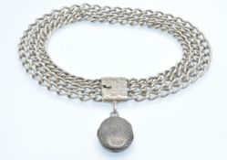 A silver locket choker necklace. The necklace strung with a silver niello chequer decorated