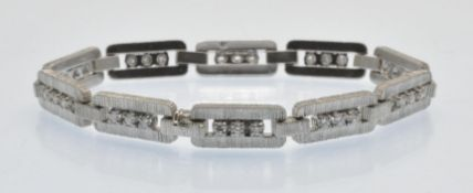 A French 18ct White Gold & Diamond Bracelet.