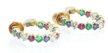 A pair of 18ct gold diamond, sapphire,  ruby and emerald earrings. The earrings with set with