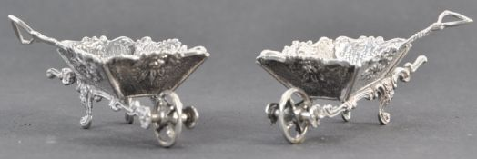 PAIR OF EDWARDIAN NOVELTY SILVER TABLE SALTS IN THE FORM OF WHEELBARROWS