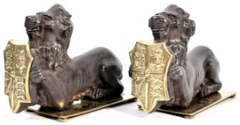 PAIR OF 19TH CENTURY CAST IRON FIRESIDE DOGS IN THE FROM OF LIONS