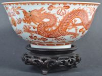 STUNNING CHINESE ANTIQUE JIAQING PORCELAIN BOWL  An 18th / 19th Century Chinese antique Jiaqing (1796-1820) mark and period porcelain bowl of remarkable quality having hand painted ocher iron red depicting two dragons chasing the flaming pearl. Six character seal mark to underside of small foot with remains of a museum / collection label. Measures: 15cm x 8cm. Condition: No visible damage. | East Bristol Auctions