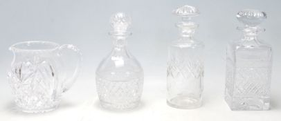 A group of 20th Century cut glass decanters to inc