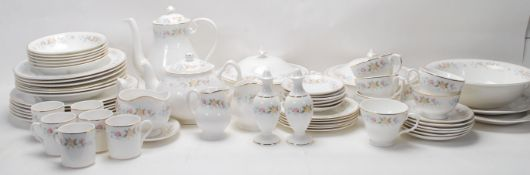 A large vintage fine bone china dinner service by