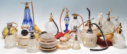 A collection of late early 20th Century Art Deco style perfume bottles of various shapes and
