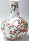 A 20th Century Chinese republic period bottle vase having a bulbous body and cylindrical neck