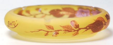 A 19th century French glass dish in the manner of Legras signed Tip. Of squat form with amber