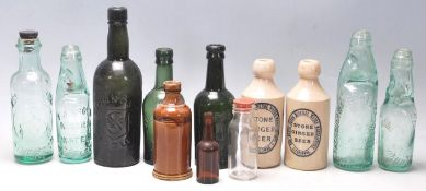 A collection of early 20th Century drinking vessels of various shapes and sizes to include stoneware