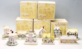 A collection of fine bone china cottages and florals by Coalport to include The Coaching Inn,