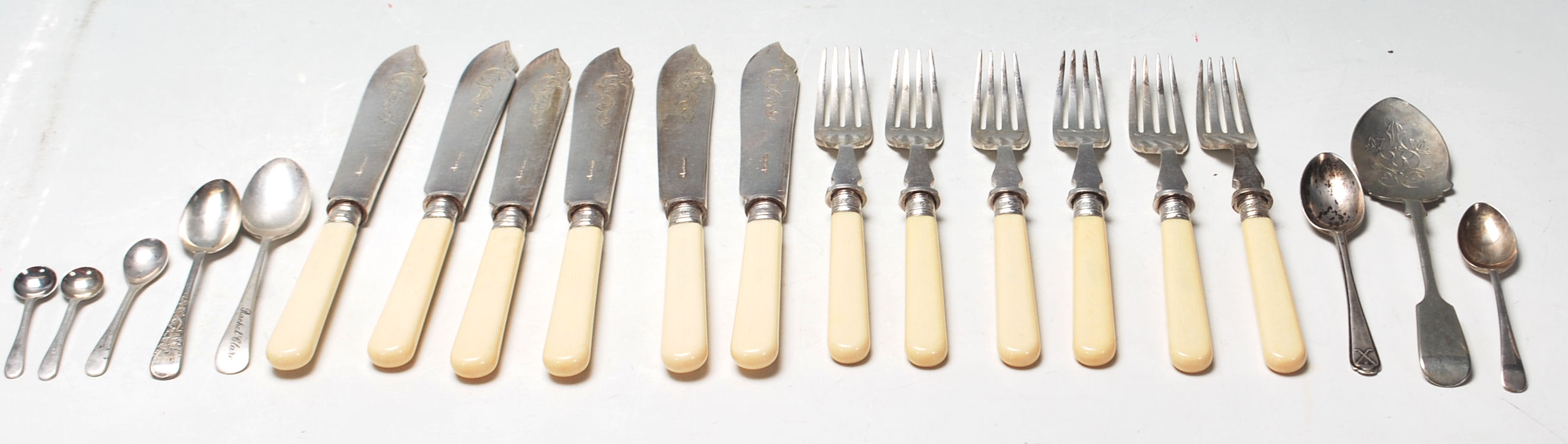 A group of seven antique and vintage silver spoons to include having a...
