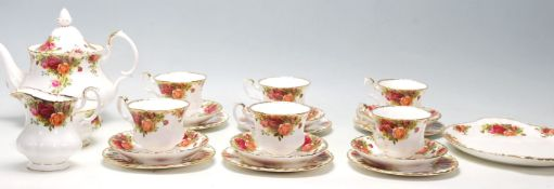 A 20th Century Royal Albert Old Country Roses tea service to include six tea cup trios, tea pot