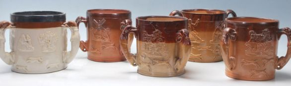 A collection of early 20th century stoneware Doulton Lambeth style havestware flagons / drinking
