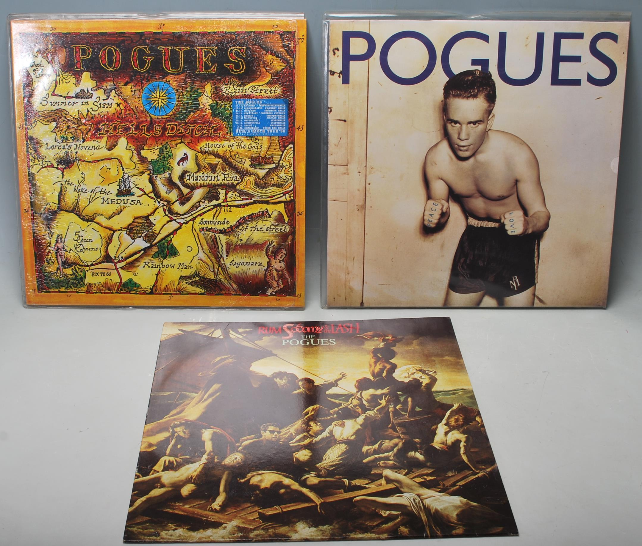 A collection of three vintage vinyl records by The Pogues to include Peace...