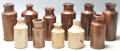 A mixed collection of early 20th Century Doulton Lambeth style stoneware flagons / drinking vessels.