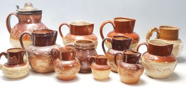 A collection of Lambert Doulton style Harvest ware / stoneware flagons / drinking vessels / jugs