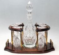 A 20th Century vintage cut glass decanter and glass set consisting of a bottle decanter complete
