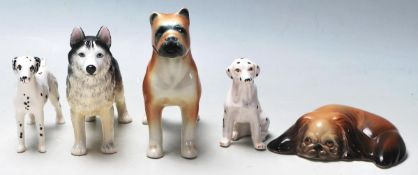 A collection of 20th Century ceramic figurines of dogs in various shapes and sizes to include a