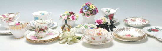 A collection of vintage early 20th Century fine bone china tea cups, trios and flower posies by