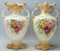A pair of Victorian 19th century Staffordshire twin handled vases. The pottery vases having gilt