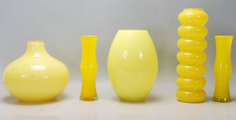 A mixed collection of retro vintage late 20th Century studio art glass ware in canary yellow to