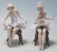 LLadro - A pair of late 20th Century vintage ceramic ballerinas comprising two seated girls getting