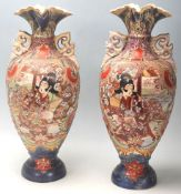 A pair of 20th Century Meiji revival Japanese vases having a flared top over a shaped body on a