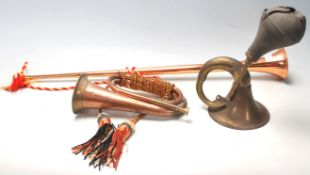 A collection of early 20th Century brass horns to
