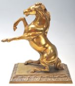 A vintage 20th century brass horse mantle ornament
