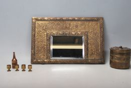 A 20th Century Arts and Crafts style mirror having