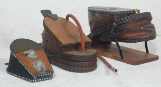 A collection of three 20th century antique foot ac
