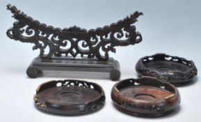 A group of four 20th Century carved Chinese hardwo