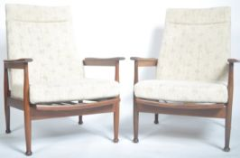 MATCHING PAIR OF TEAK FRAMED RECLINING LOW EASY ARMCHAIRS BY GREAVES AND THOMAS