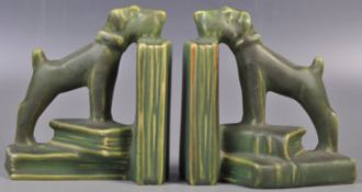 PAIR OF EARLY 20TH CENTURY ART DECO CERAMIC DOG BOOKENDS