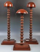 GROUP OF THREE MAHOGANY SHOP / HABERDASHERY HAT DISPLAY STANDS