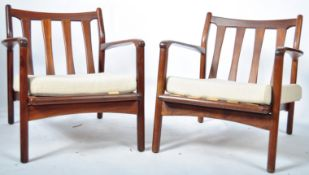 PAIR OF TOOTHILL AFROMOSIA WOOD ARMCHAIRS RETAILED BY HEALS