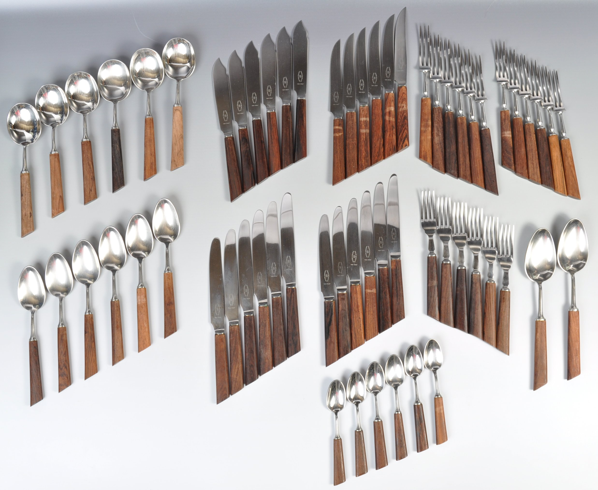 Lot 24 - GEORGE BUTLER SHEFFIELD STAINLESS STEEL AND TEAK HANDLED CUTLERY SERVICE