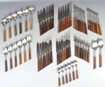 GEORGE BUTLER SHEFFIELD STAINLESS STEEL AND TEAK HANDLED CUTLERY SERVICE