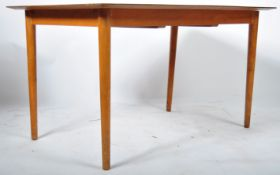 BELIEVED ALFRED COX FOR HEALS EXTENDING DINING TABLE