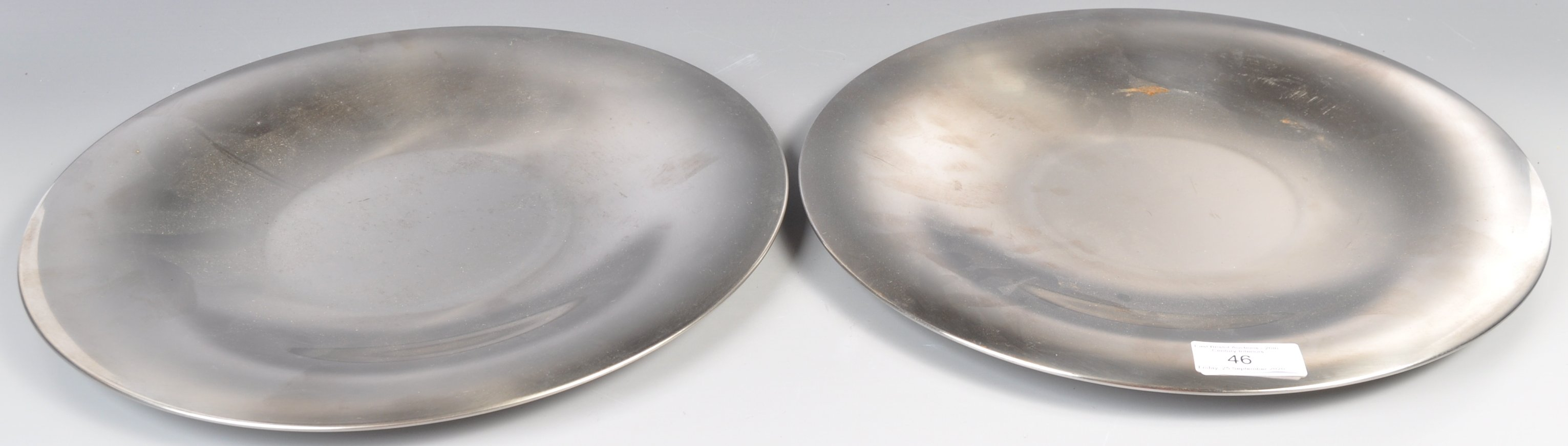 PAIR OF DANISH STAINLESS STEEL PLATES BY LONE SACHS FOR LUNDTOFTE