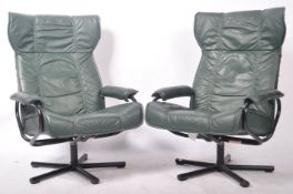 KEBE PAIR OF DANISH GREEN LATHER WINGBACK SWIVEL ARMCHAIRS