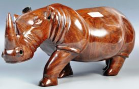A STUNNING LARGER AND IMPRESSIVE HAND CARVED ROSEWOOD RHINO STATUE