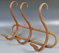 EARLY 20TH CENTURY BENTWOOD WALL MOUNTED COAT RACK IN TH MANOR OF THONET