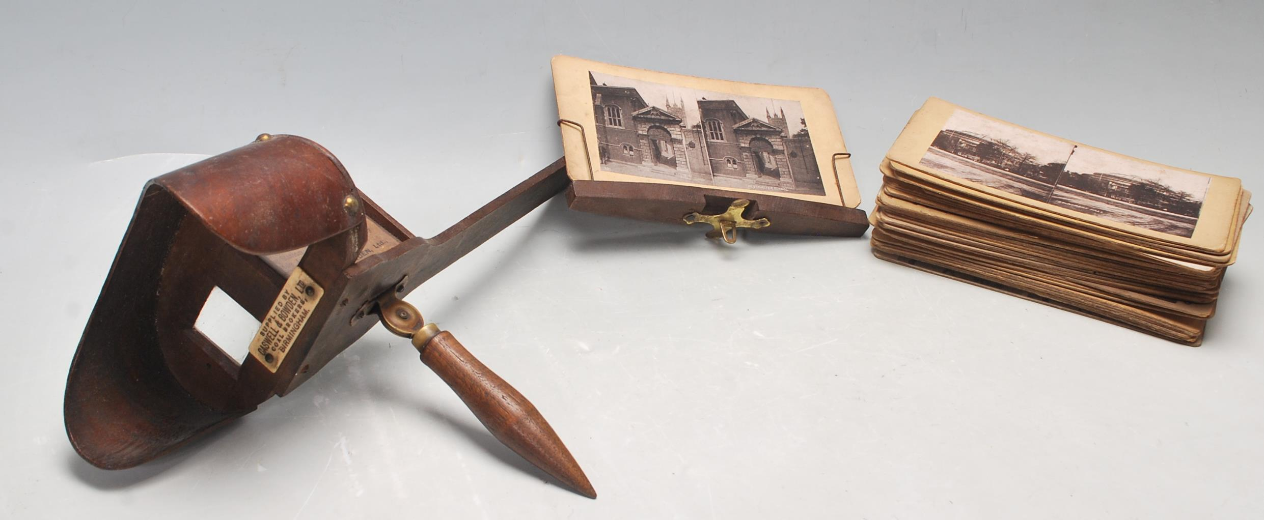 A LATE 19TH CENTURY VICTORIAN STEREOSCOPE VIEWER WITH SLIDES OF LONDON, BIRMINGHAM AND SOUTH AFRICA
