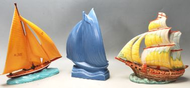 THRE 20TH CENTURY STUDIO ART POTTERY VASES IN A SHAPE OF BOATS AT SEA