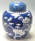 19TH CENTURY CHINESE GINDER JAR PAINTED IN BLUE AND WHITE PRUNUS PATTERN