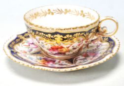 A 19TH CENTURY GEORGIAN COBALT BLUE AND GILT TEA CUP AND SAUCER