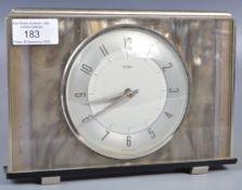MID CENTURY CHROME AND LUCITE CLOCK BY METAMEC