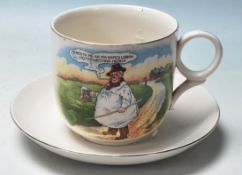 A large early 1900's Victorian Tykes Motto Teacup