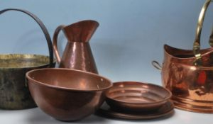 A quantity of early 20th century copper vessels an